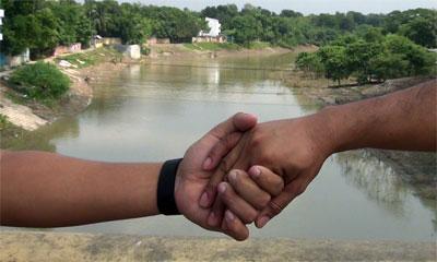 মাথাভাঙ্গা নদী সংস্কার ও খননের দাবিতে মানববন্ধন